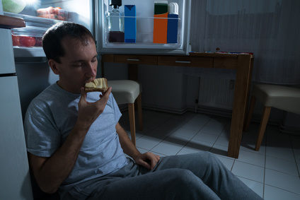 Portrait Of A Man Eating Cheese Bread At Home