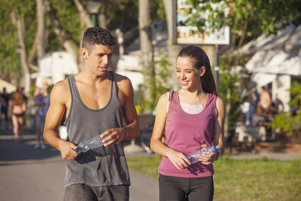 Couple walking after workout outdoors